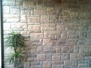 Wall cladding concrete tiles on brick wall