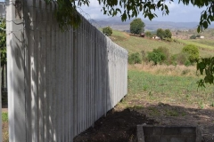 Concrete palisade fence 2.4m high around reservoir
