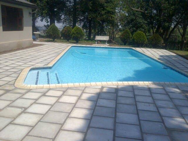 Poolside coping and paving
