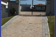 Cobble Paving Driveway with Steel Gate